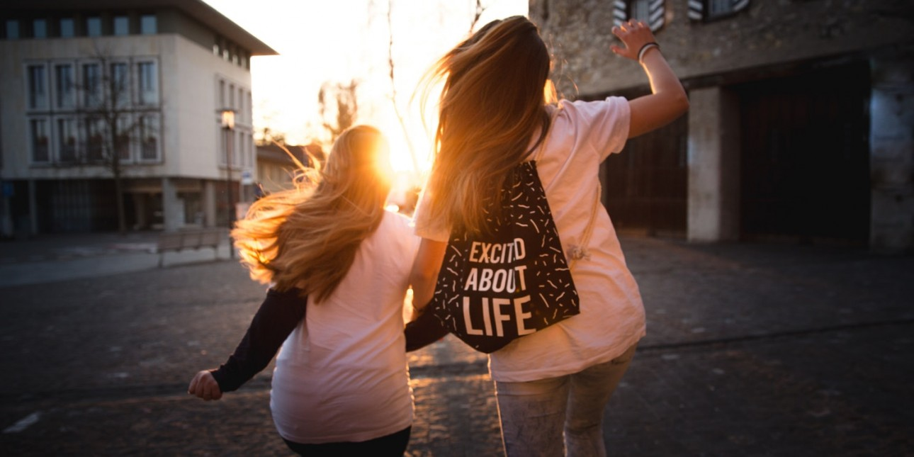 Positive Youth Development - Two girls dancing into the sunrise.