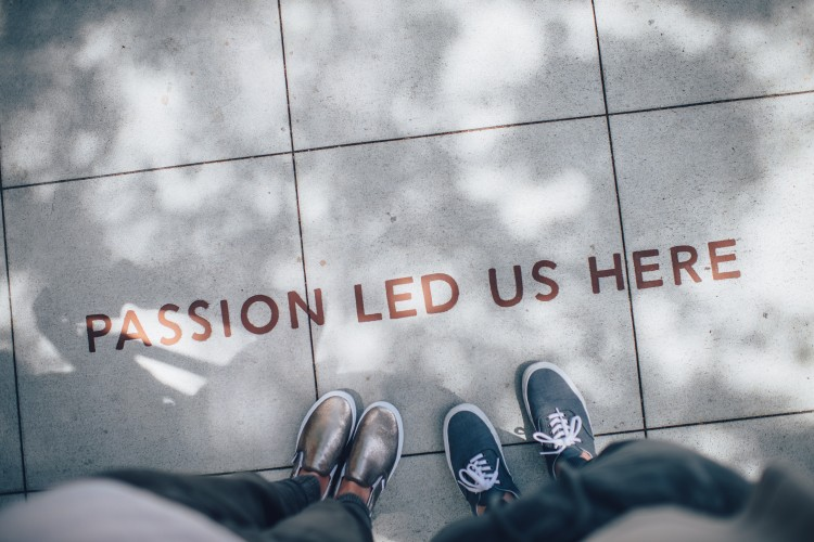 "words on side walk, ""passion led us here"""